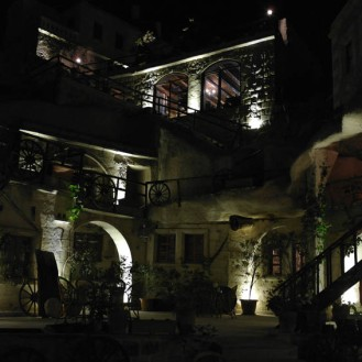Shoestring Cave Hotel glows with romantic charm at night